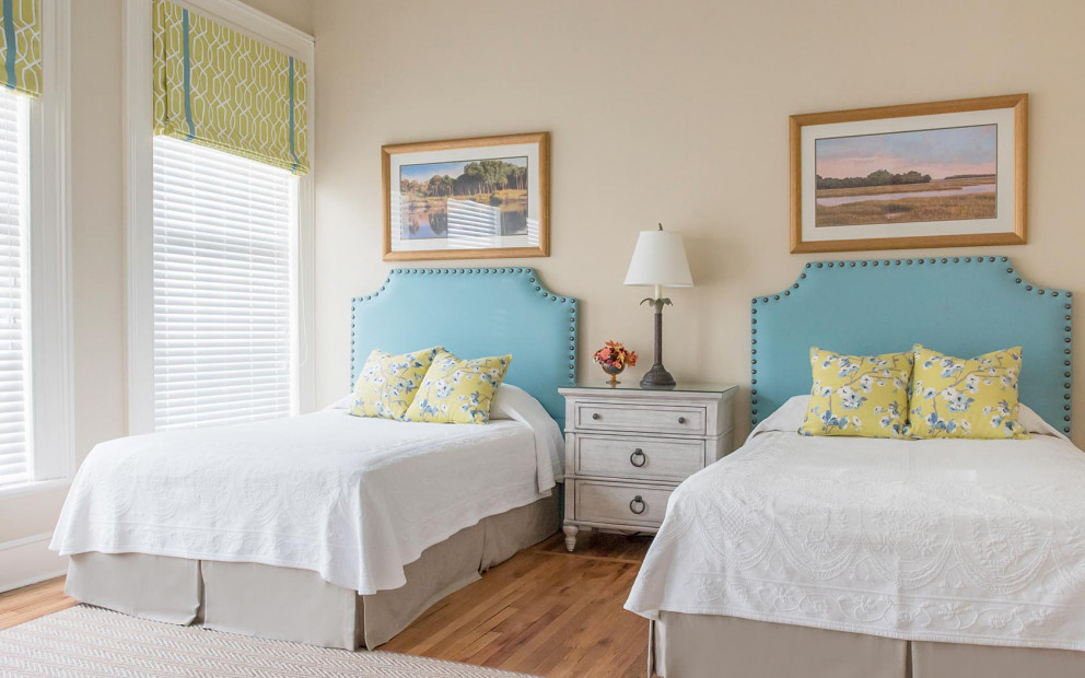 twin beds with white bedding and yellow pillows