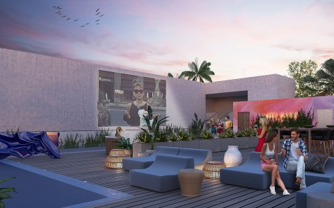 sunset rooftop image with movie playing on wall and people on couch