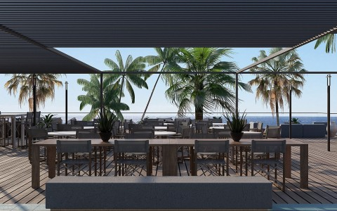 rooftop with shot of palm trees and ocean views with long table seating