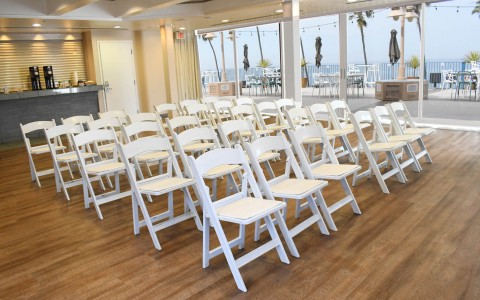 rows of white chairs prepared for a ceremony
