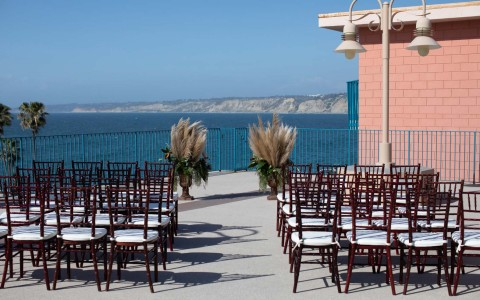 dark wood chairs lined up for a wedding ceremony