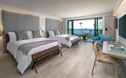 room with two queen beds and ocean view