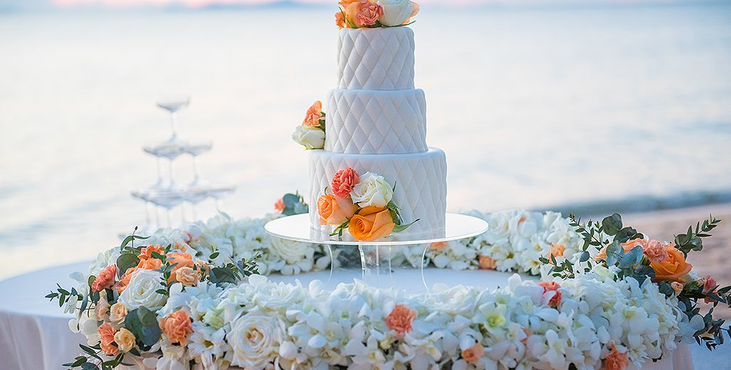 wedding cake with a beach back drop