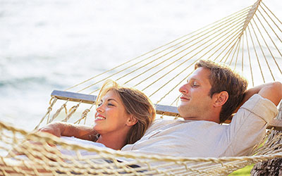 couple relaxing in a hammock