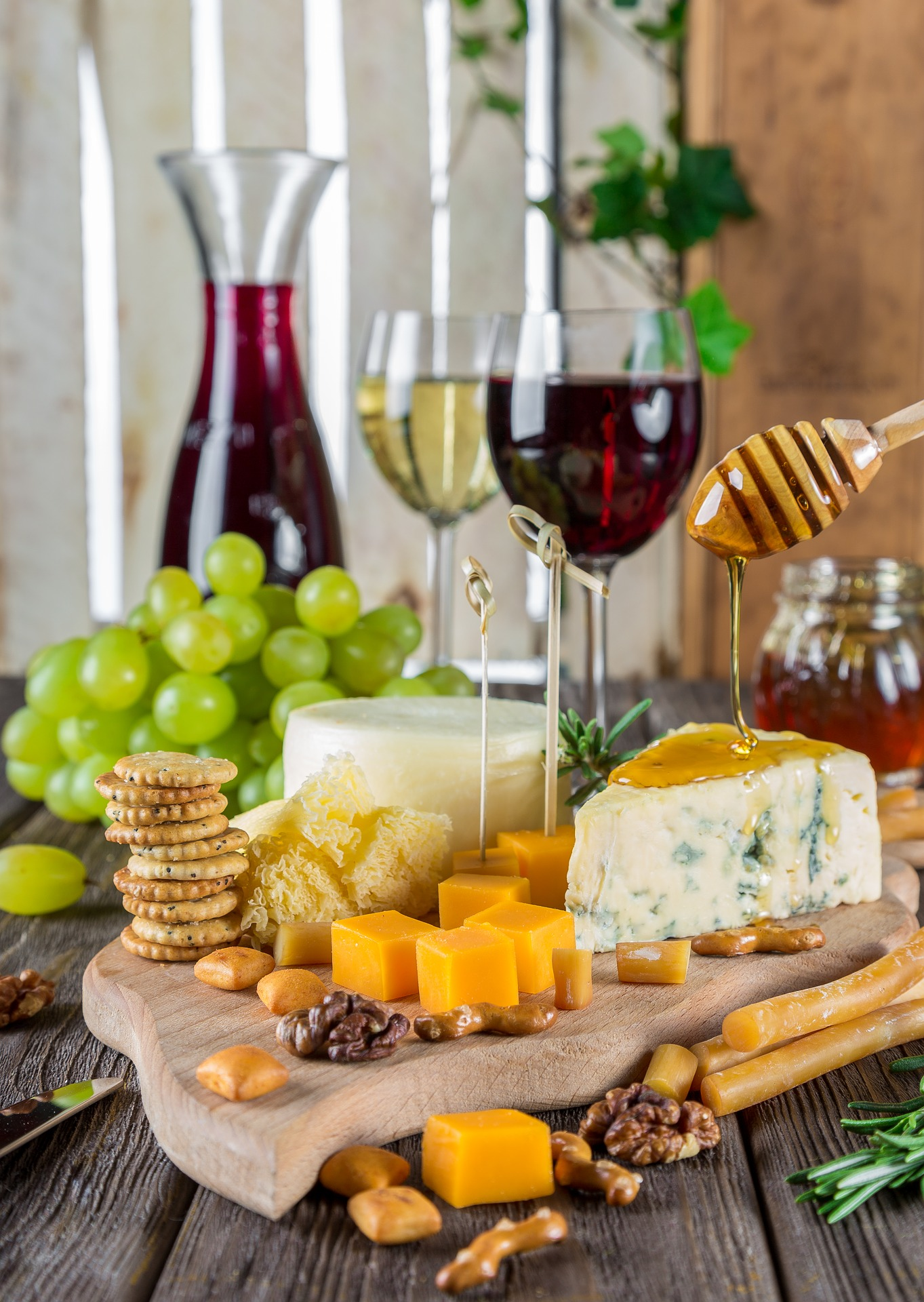 Glasses of wine cheeses and crackers decoratively arranged