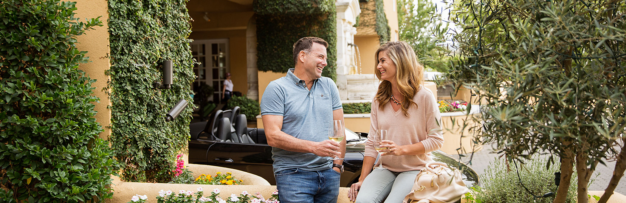 Couple laughing in hotel courtyard