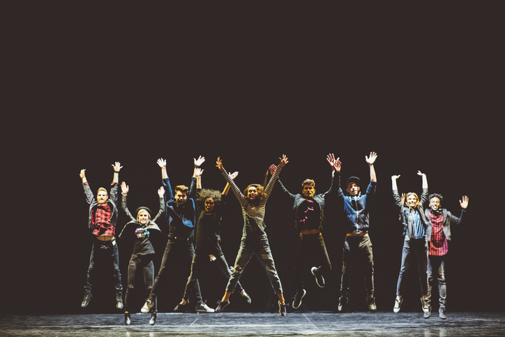 actors jumping on stage