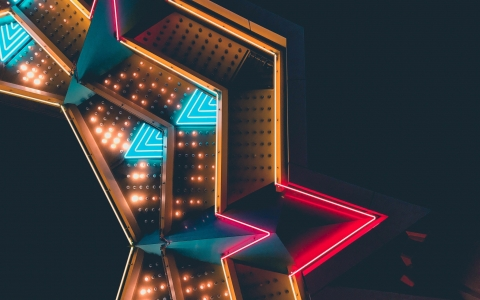 Abstract arrangment of neon lights and metal against a black background