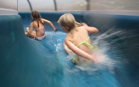 Two girls going down Water Slide