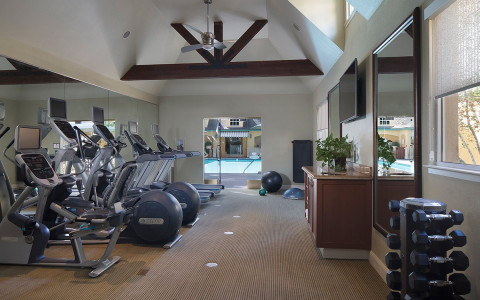 a room with dumbbells and exercise equipment