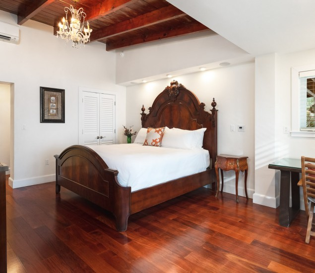 large spacious room with wooden bedframes and wooden high ceilings
