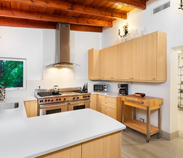 Kitchen with white countertops and large industrial stove