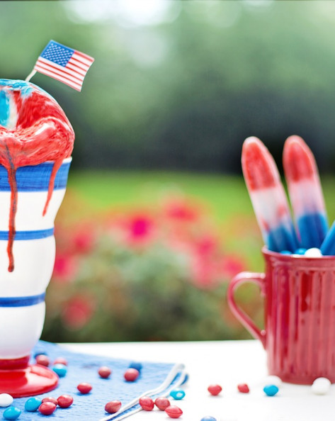 Fourth of July themed ice cream and popsicles on picnic table