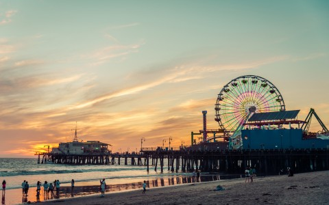 beach view of pier with ferris wheel