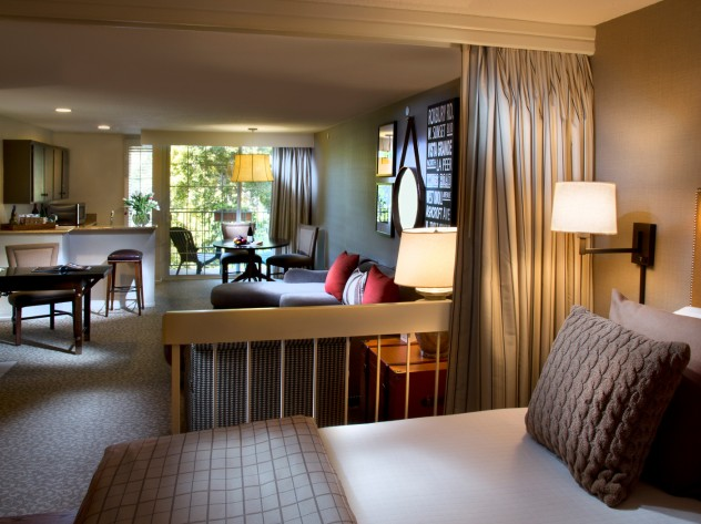 king suite with king bed living room and kitchenette