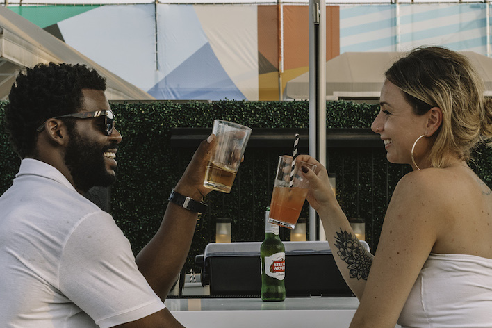 couple sharing drinks at rooftop bar