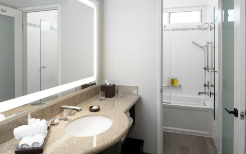 Bathroom with sink, mirror, and tub