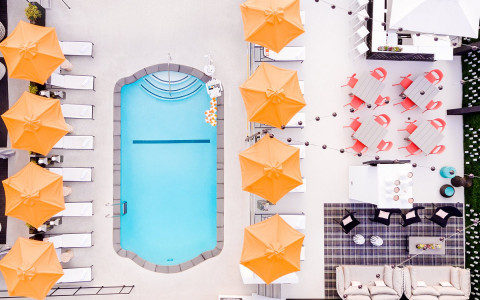 Overhead view of pool area with umbrellas opened