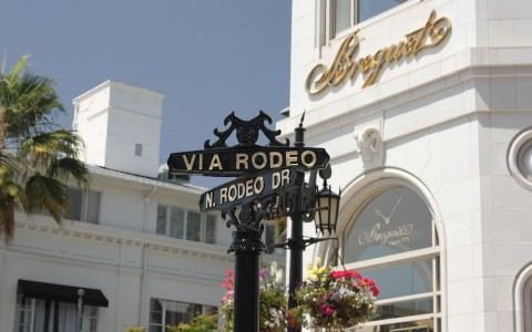 Rodeo drive sign in front of a boutique