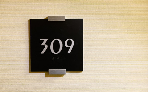guest room sign with braille
