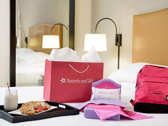 Shopping bag and tray of food sitting on hotel bed