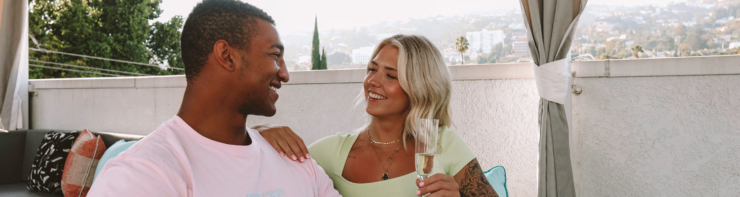Couple enjoying champagne outdoors