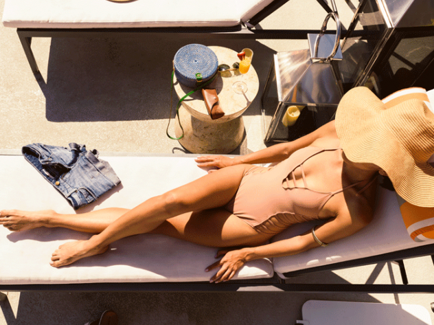 woman in bathing suit sunbathing