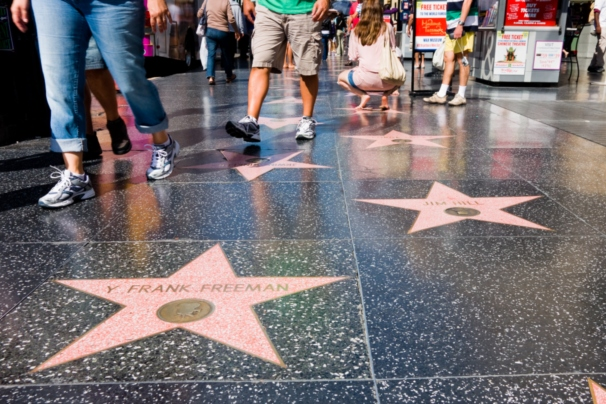 pedestrians strolling hollywood walk of fame