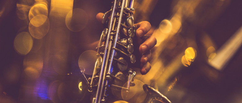 Close up of hand playing sax