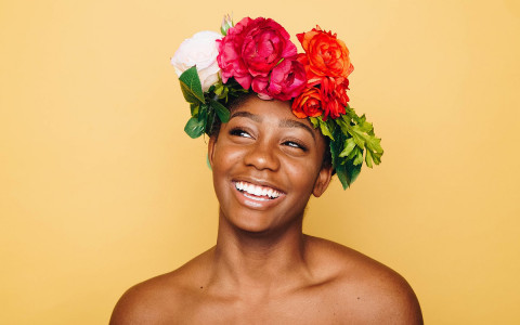 Woman with colorful flower headpiece