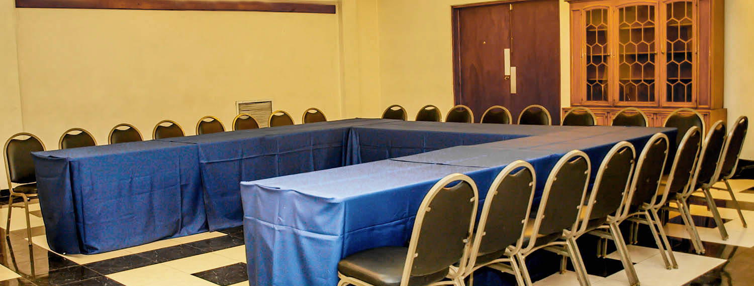 Tables set in u formation for meeting