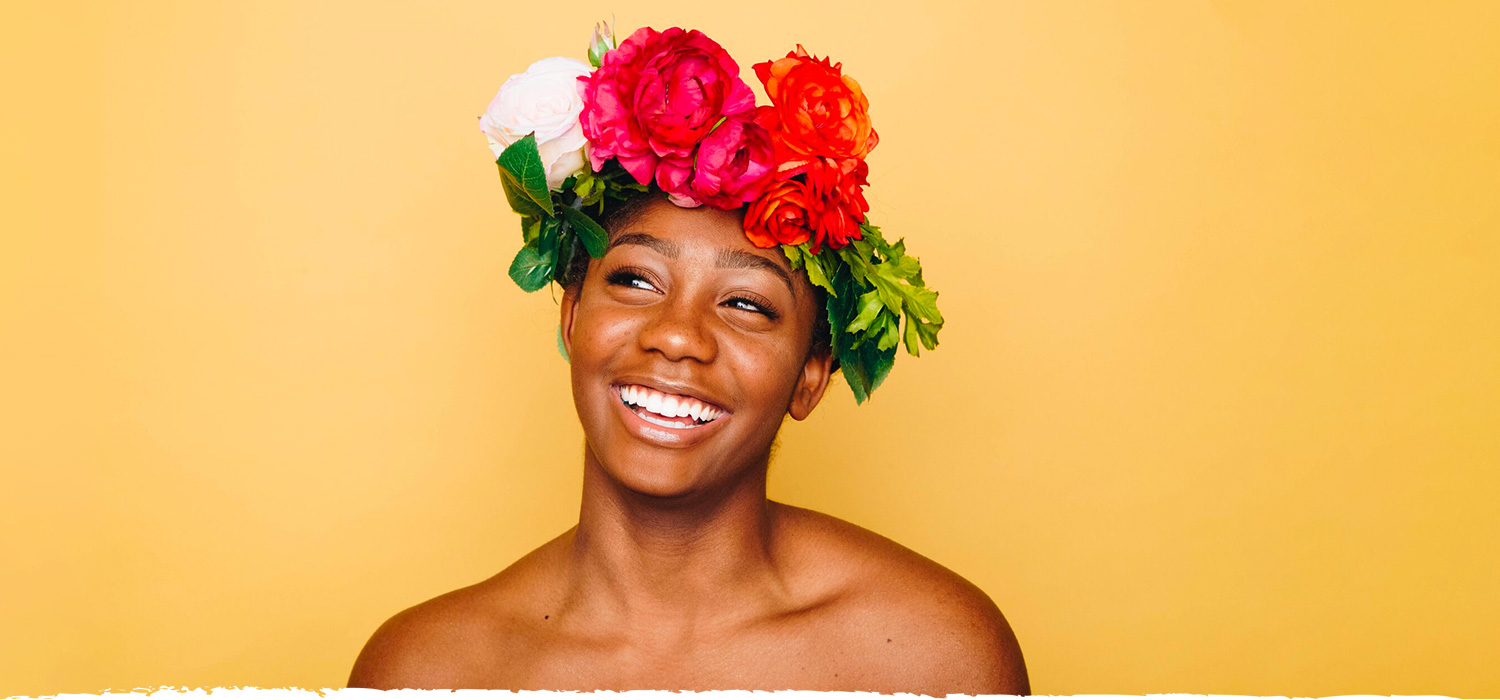Woman with colorful flowered headpiece