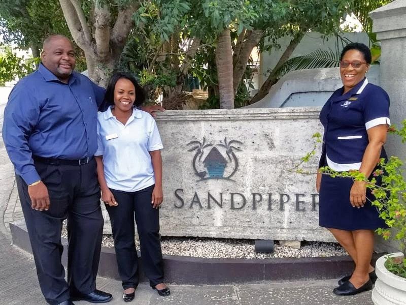Staff standing next to sandpiper sign