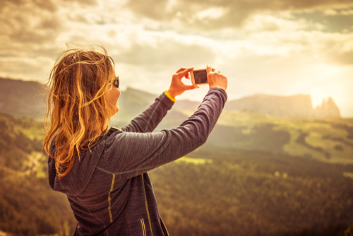 woman photographing the mountains