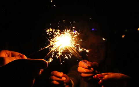 Assorted Hands Holding Sparklers