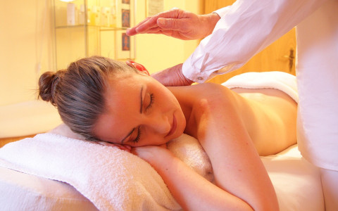 Woman Experiencing a Professional Massage