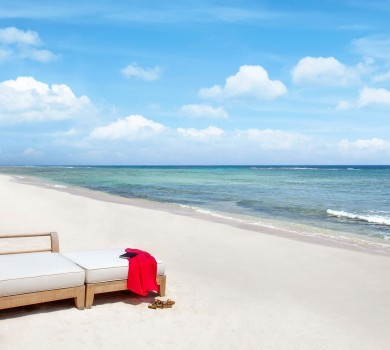 Cushioned lounge chair on the beach