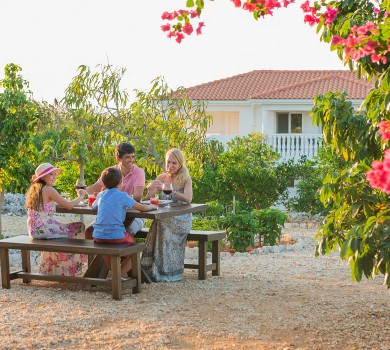 family dines outside in the hotel garden