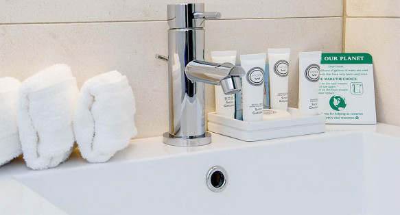 Guest bathroom white porcelain sink and bath amenities