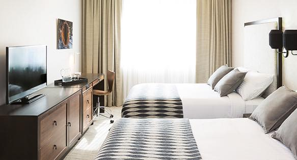 Guest room bed with diamond duvet