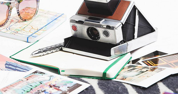Vintage polaroid camera on a white desk