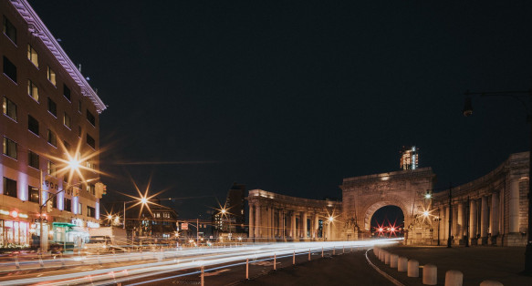 Architectural arch over road entrance to Manhattan bridge at night