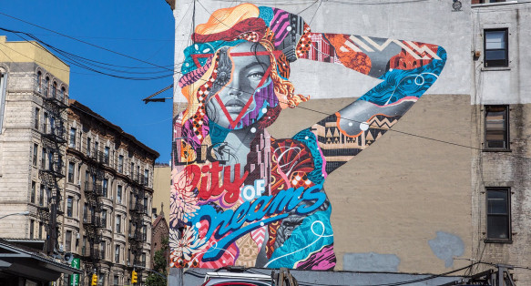 Colorful mural of a woman on the side of a building
