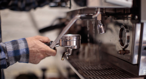 Closeup of person making espresso