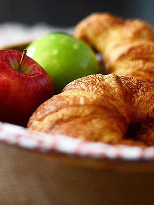 apples and bread in a basket