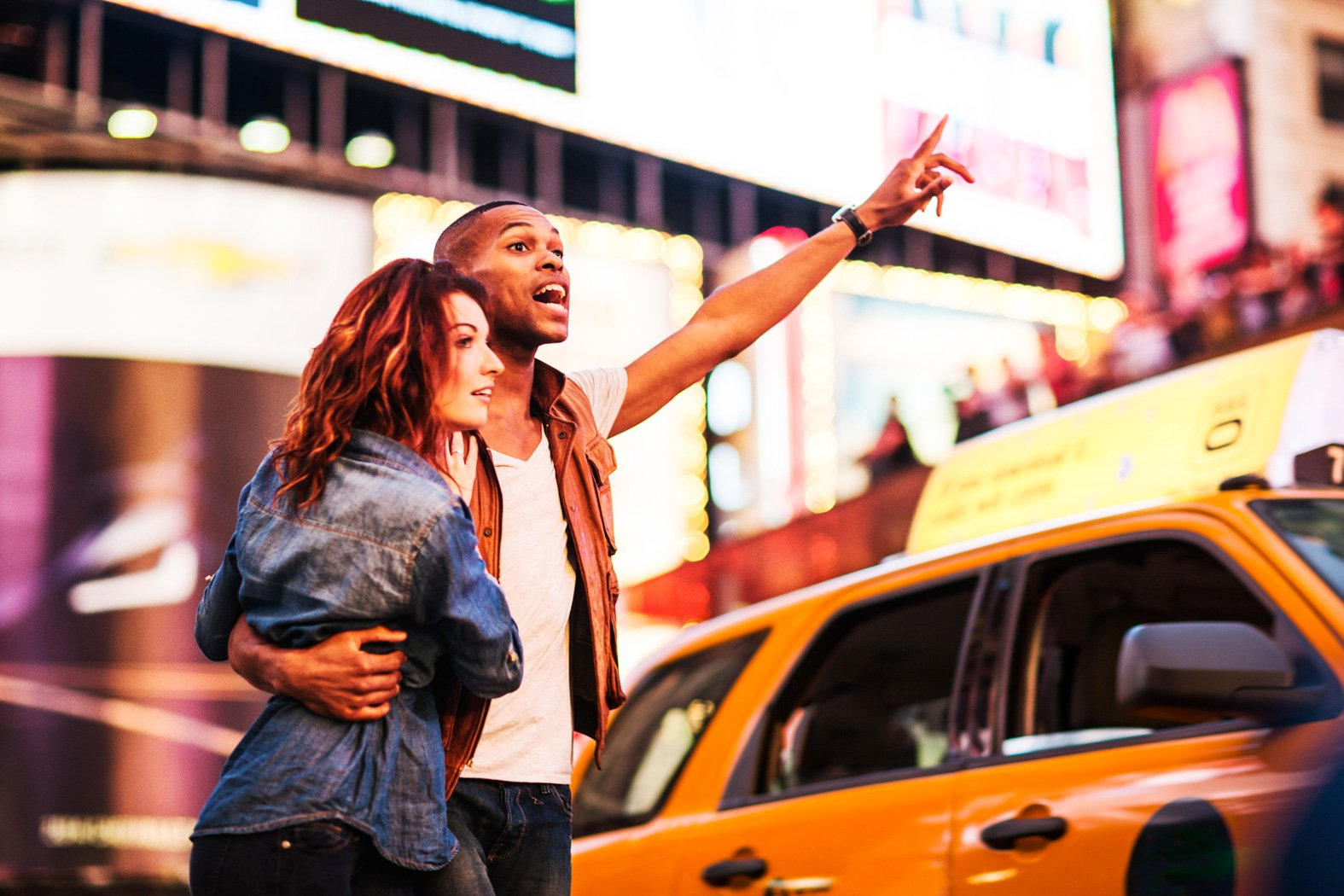 a couple calling a cab in new york city