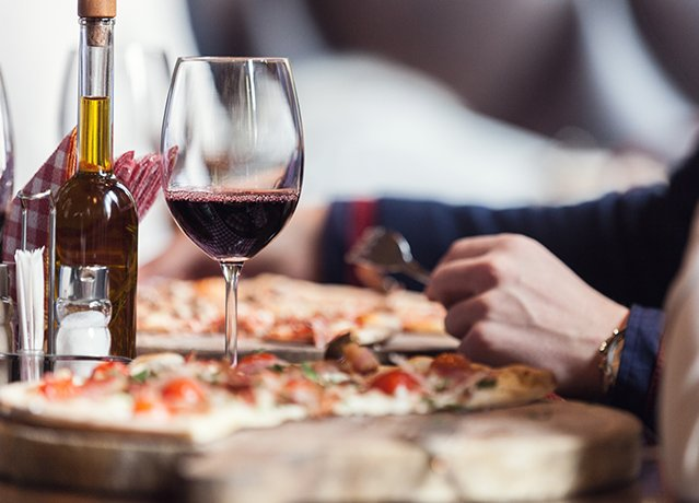 pie of pizza and a glass of red wine