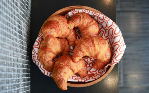five croissants  in a basket