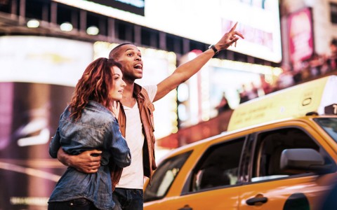 couple calling for a yellow cab