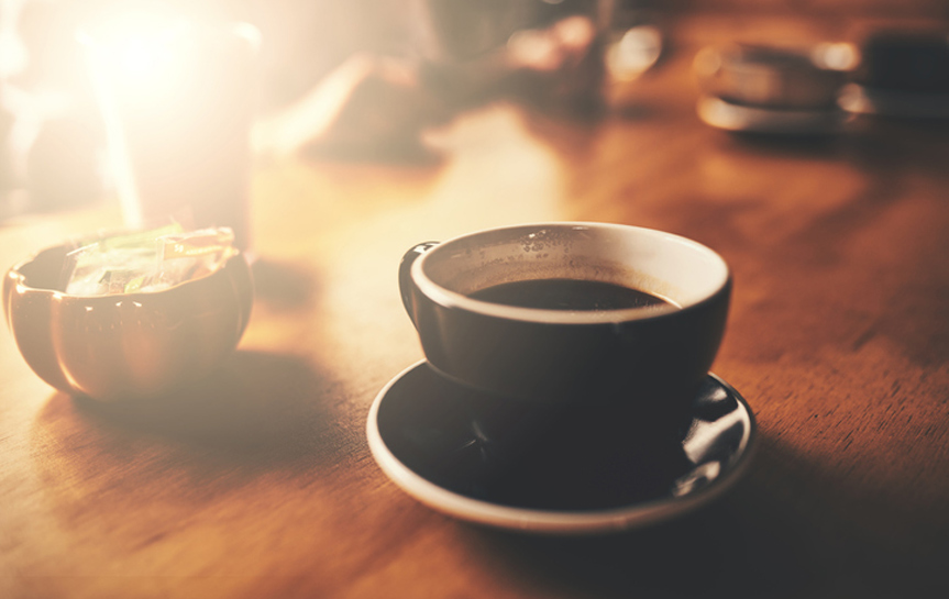 close up of coffee cup with lens flare